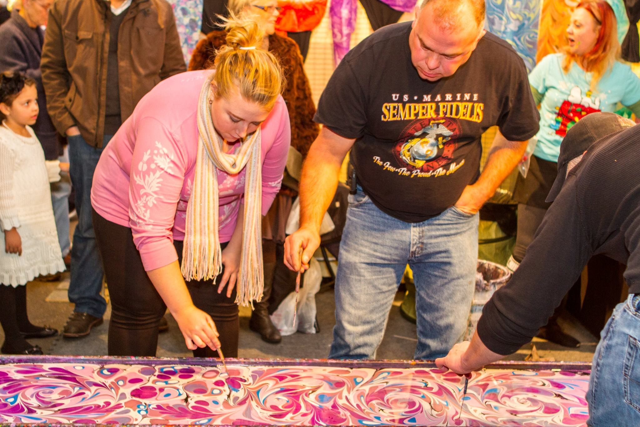Waterford Fair-goers trying Turkish marbling.